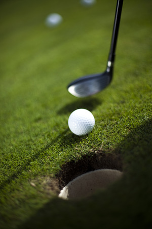 golf glove: Golf ball on green meadow, driver