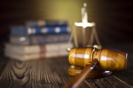 Mallet of judge, legal code and scales Stock Photo