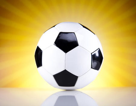 Soccer ball and sunshine photo