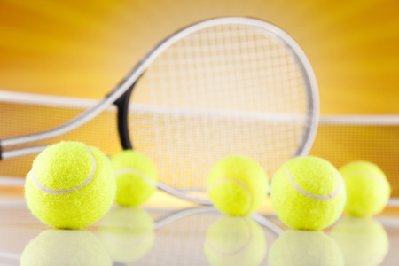 Tennis racket and balls photo