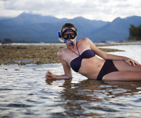 skin diving: Island woman and diving  Stock Photo