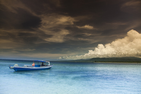 Boat on the blue lagoon of Gili Air, Indonesia  photo
