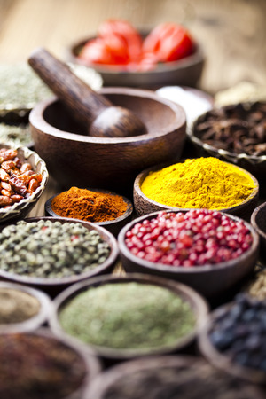 Spices on wooden bowl background  photo