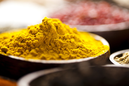 Curry, Wooden bowl spice  photo