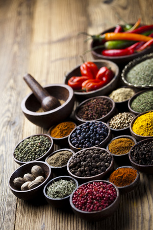 Spices on a wooden table photo