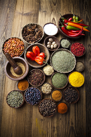 Assortment of spices in wooden bowl background  photo