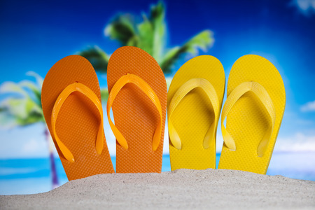 flip flops: Flip flops on the beach