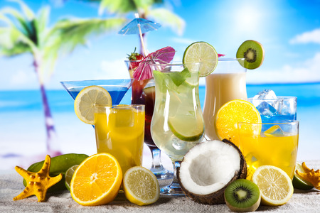 Summer drink with beach on background  photo