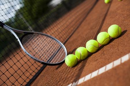 Tennis racket and balls, court photo