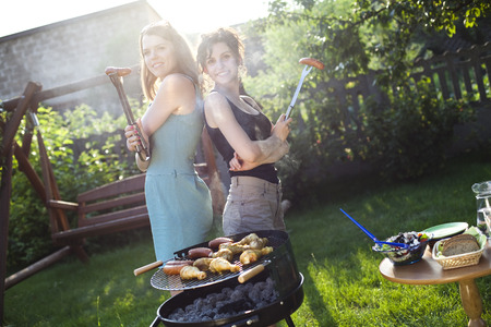 Two girls on grill  photo