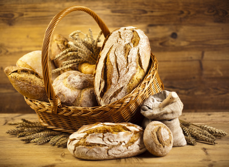 pumpernickel: Composition with bread and basket Stock Photo