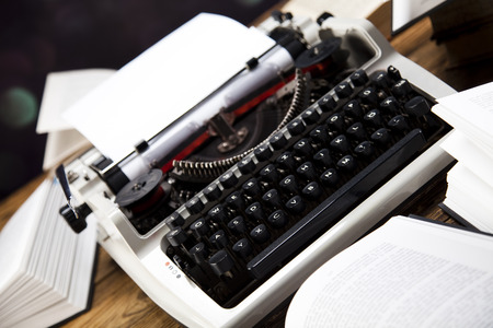 Vintage typewriter on old book photo