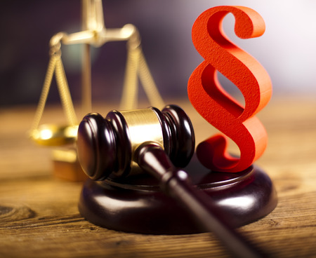 Wooden gavel barrister and paragraph symbol photo
