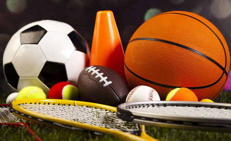 soccer ball on grass: Assorted sports equipment and grass
