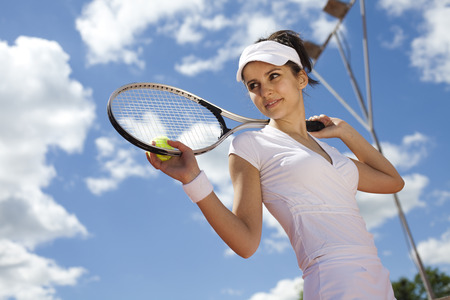 sports activities: Young woman tennis player on the court Stock Photo
