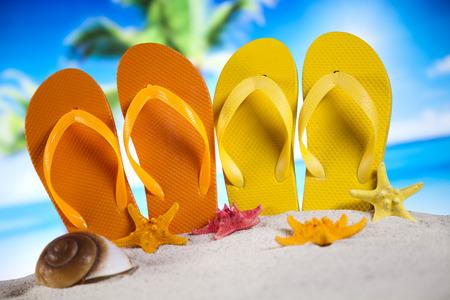 Colorful flip flops on beach photo