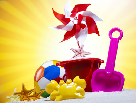 Toy windmill and beach accesories photo