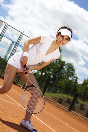 Young woman tennis player on the court  photo