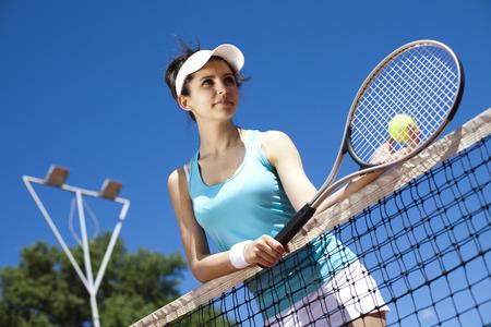 Girl Playing Tennis  photo