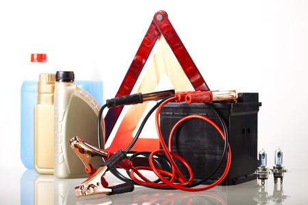 Set of auto parts, car battery on vivid moto concept photo
