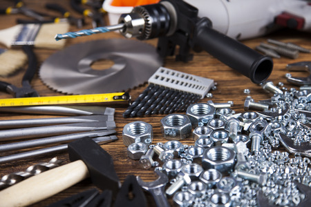 triplet: Working tools on wooden background Stock Photo