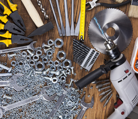 shrewd: Set of different tools on wooden background
