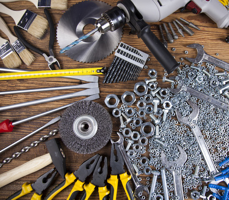 triplet: Set of different tools on wooden background
