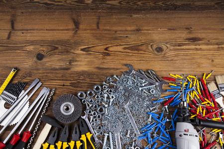 shrewd: Assorted work tools on wood background