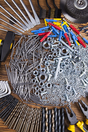 shrewd: Working tools on wooden background Stock Photo