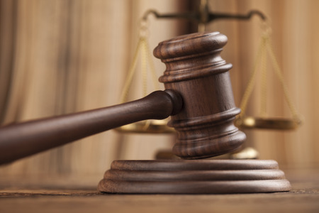 legally: Law theme, mallet of judge, wooden gavel