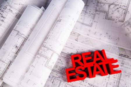 bienes raices: Real estate agency concept and blueprints