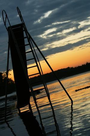 Slide set into the lake,taken at sunset. photo