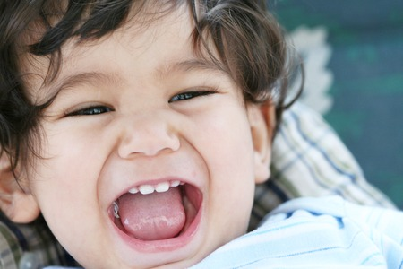 mouth opened:  boy filled with joy,mouth opened and smiling. Stock Photo