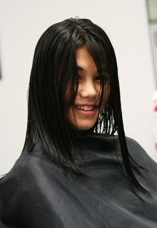 haircut: Teenage girl getting a haircut
