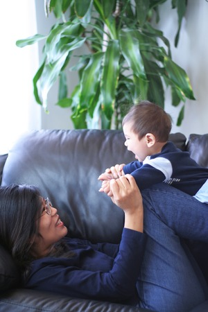 sofa: Playtime with mom Stock Photo