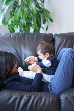couch: Playtime with mom Stock Photo