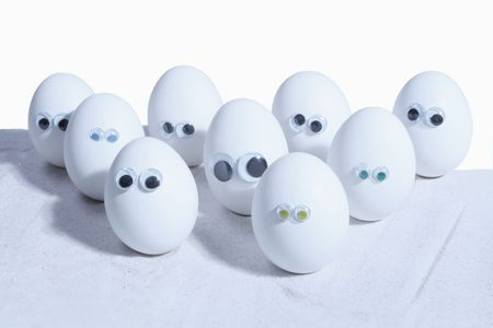 Eggs with eyeballs, lined up in row, Egg people. Add your own expressions photo