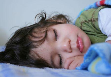 sweet seventeen: Beautiful sleeping boy  toddler. Part Scandinavian, thai background Stock Photo
