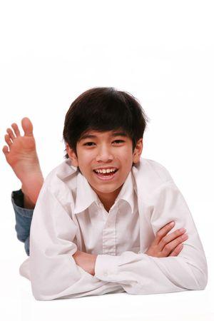 Handsome young teen boy lying on floor, part Asian- Scandinavian descent Stock Photo - 4478771