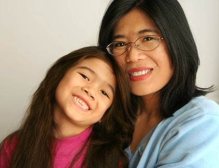 minority: Asian mother and daughter sitting together