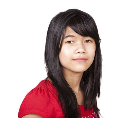 Preteen biracial girl in red shirt in studio photo