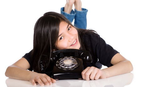 eleven: Young girl lying by old phone