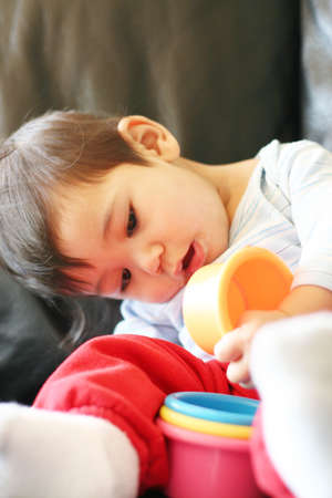 scandinavian people: Baby boy playing with colorful toys