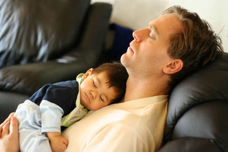 scandinavian people: Father, baby sleeping like babies,    note : focus on baby Stock Photo