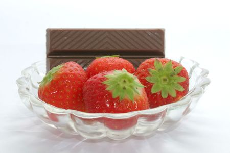 Strawberries and chocolate in glass bowl photo