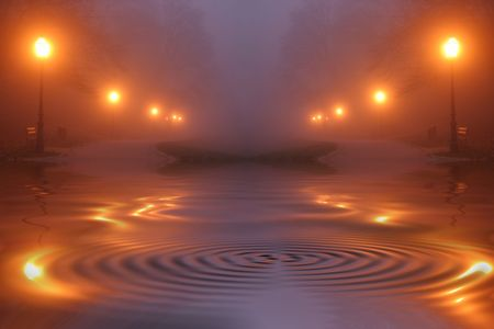 myst: Street lights in fog at night Stock Photo