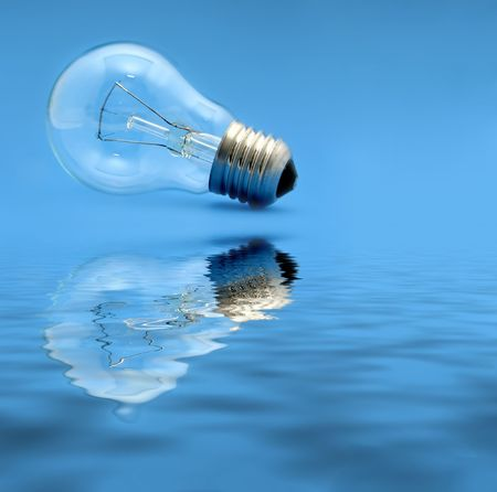 Old light bulb with reflection photo