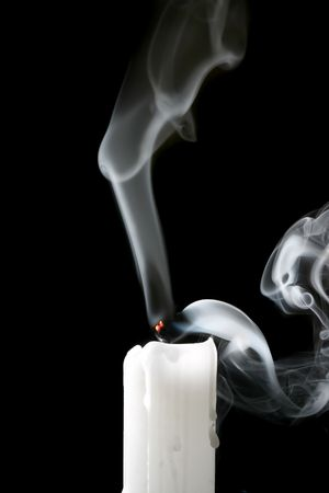 blown: Candle and smoke on black background Stock Photo