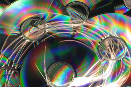 gigabytes: Abstract background of colorful CDs