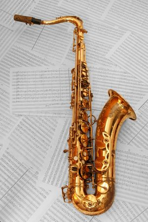 Old golden saxophone on note paper Stock Photo